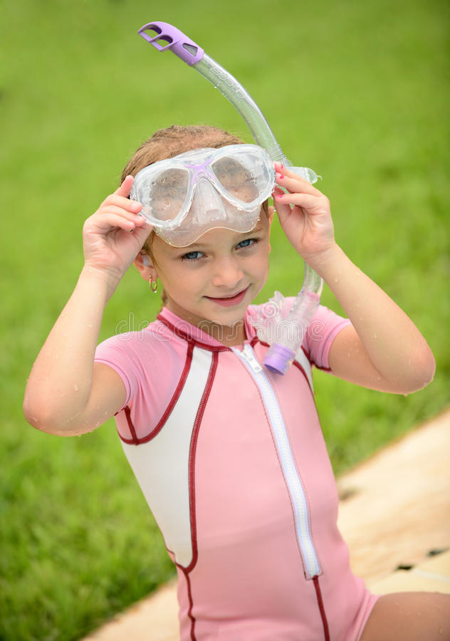 Pretty girl with goggles and snorkel in summer. Time stock photos