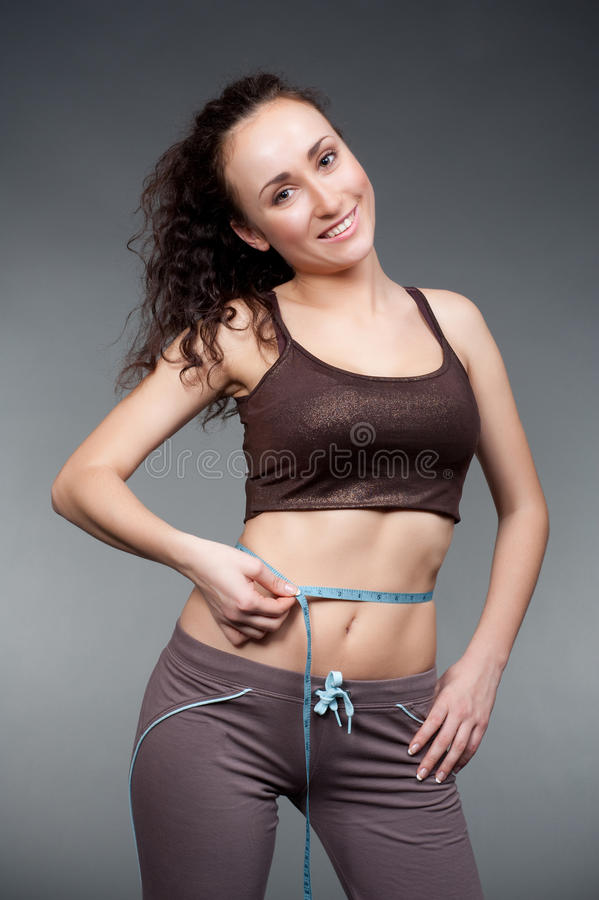 Pretty girl in good fit. Measurement her waist royalty free stock images