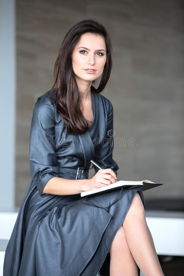 Pretty girl in a gray suit royalty free stock image