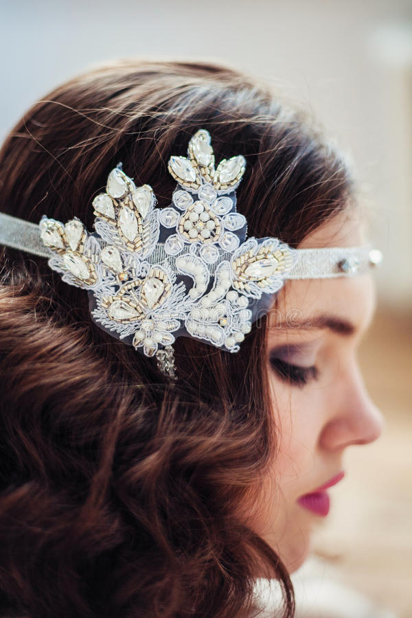 Pretty girl with handmade floral headband. Professional make-up and hairstyle. Perfect skin. Fashion photo. Gatsby style royalty free stock images