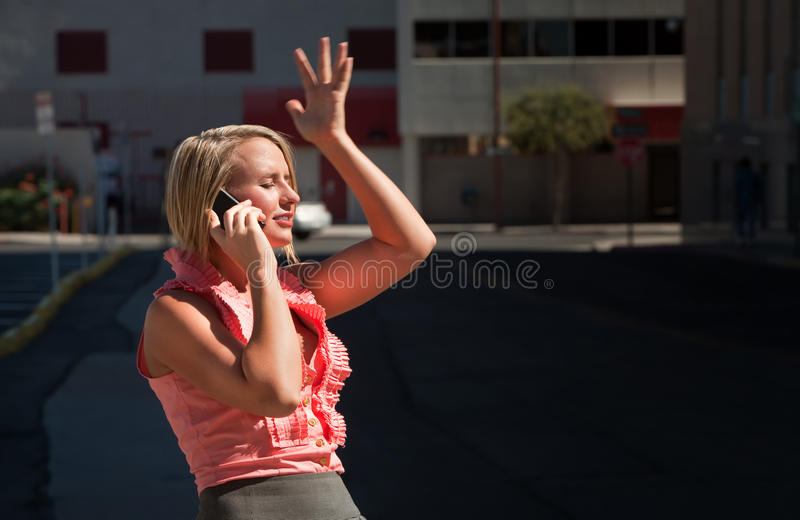 Pretty girl has ah-ha moment talking on cell phone stock image