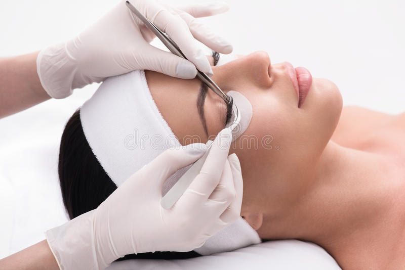 Pretty girl having her lashes lengthened stock images