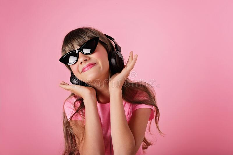 Pretty girl in headphones listening to the music. summer girl royalty free stock photo