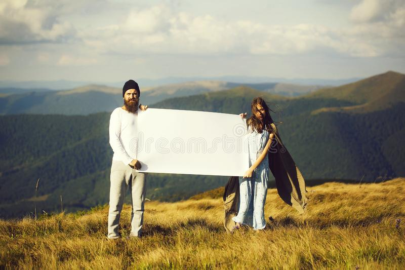 Girl amd man with banner royalty free stock image