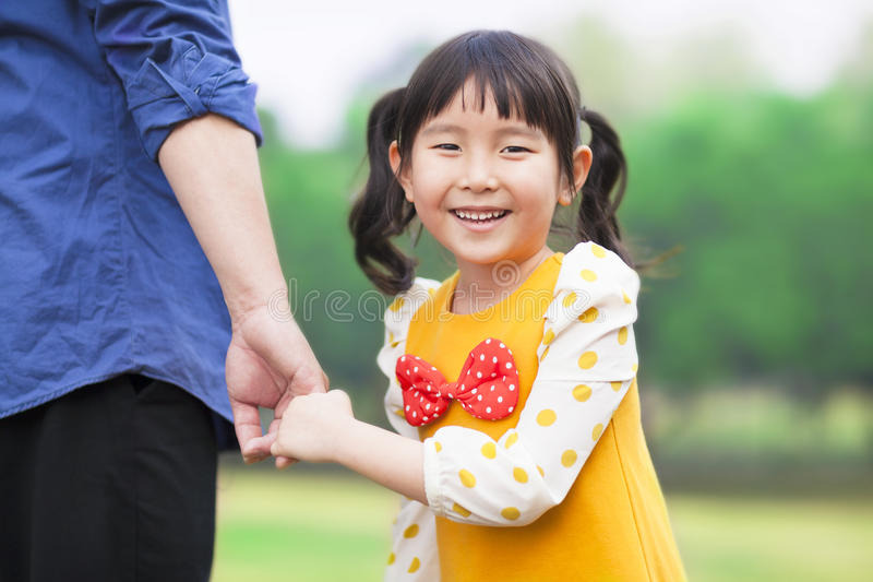 Pretty girl hold father hand stock photography