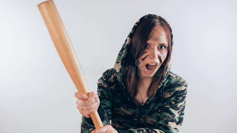 Girl with a bat. girl or criminal woman, holding baseball bat in hand on white background. Body art. Sport and training royalty free stock photography