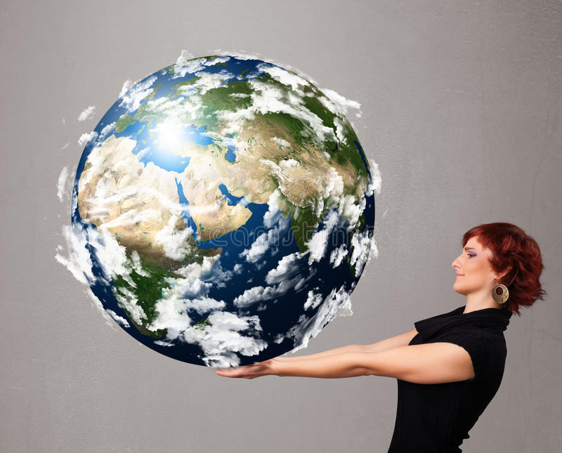 Pretty girl holding 3d planet earth. Pretty young girl holding 3d planet earth royalty free stock photography