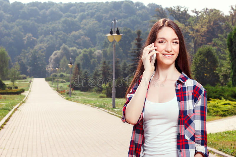Pretty girl holding mobile phone stock photos