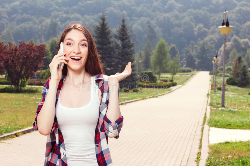 Pretty girl holding mobile phone royalty free stock photography