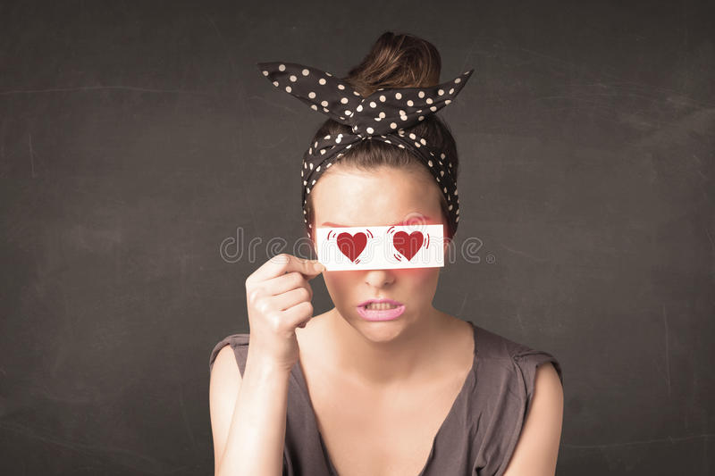 Pretty girl holding paper with red heart drawing. Concept royalty free stock photos
