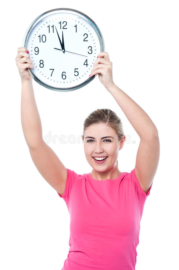 Pretty Girl Holding The Wall Clock Stock Photography