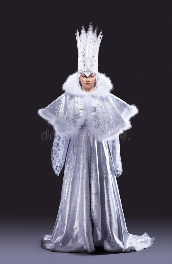 Pretty girl in ice queen carnival costume stock photos
