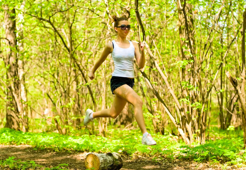 Pretty girl jogging stock photos