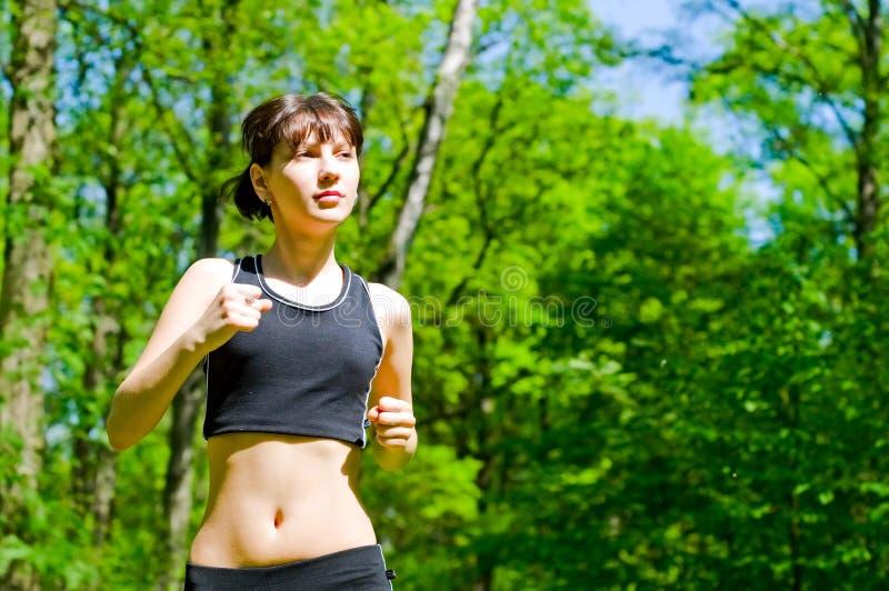 Pretty girl jogging stock photography