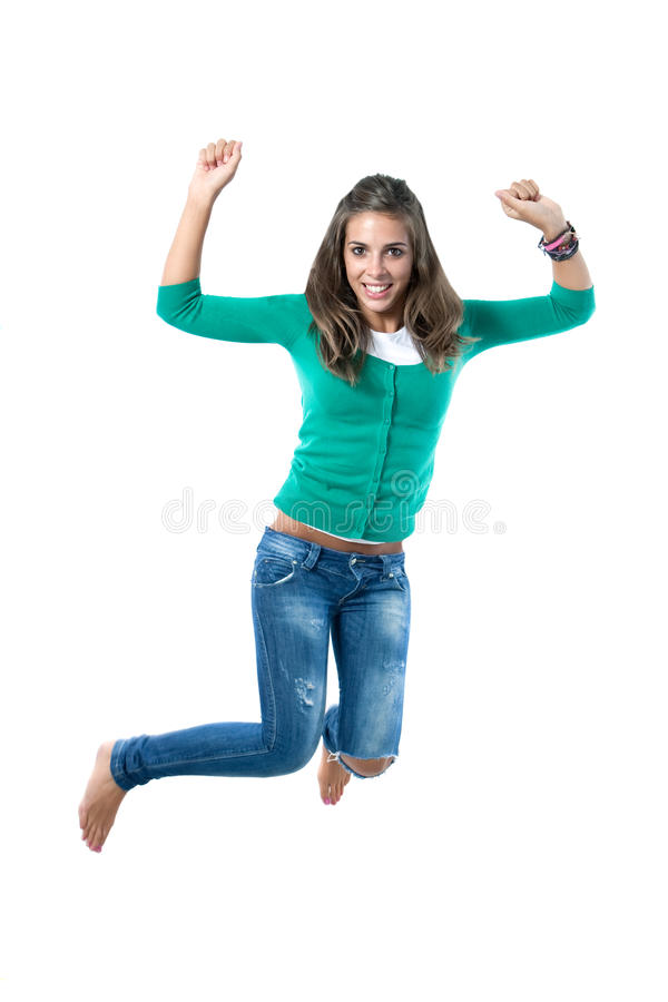 Pretty girl jumping. Isolated on a over white background stock images