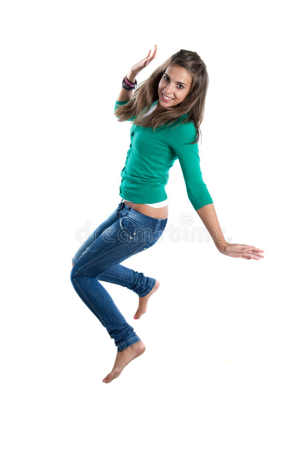 Pretty girl jumping. Isolated on a over white background stock image