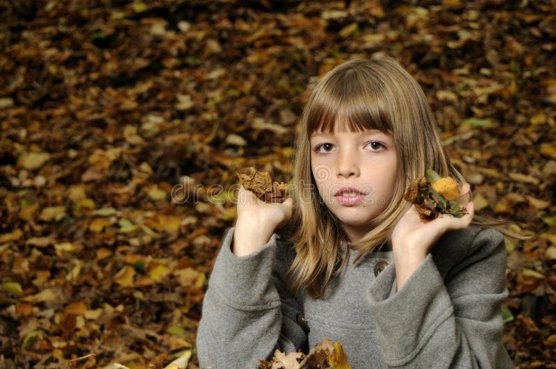 Pretty girl with leaves stock images