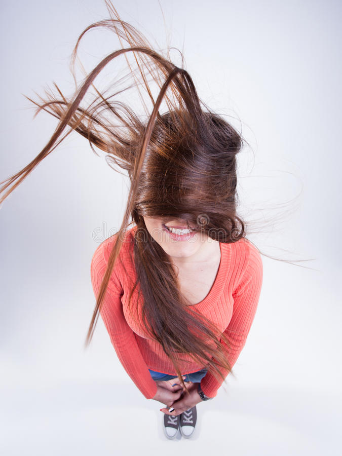 Pretty girl with long hair blowing in the wind smiling stock images