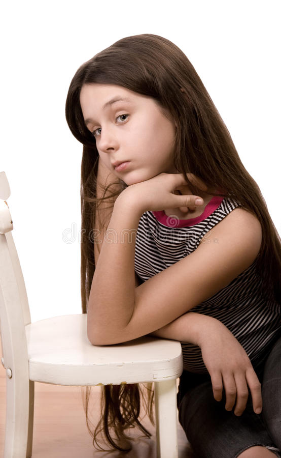 Pretty girl looking and dreaming sitting on white stock images