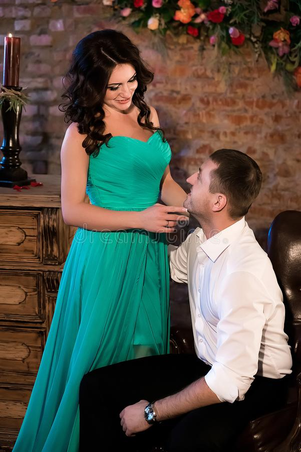 Pretty girl looking at her sitting man smiling stock photos