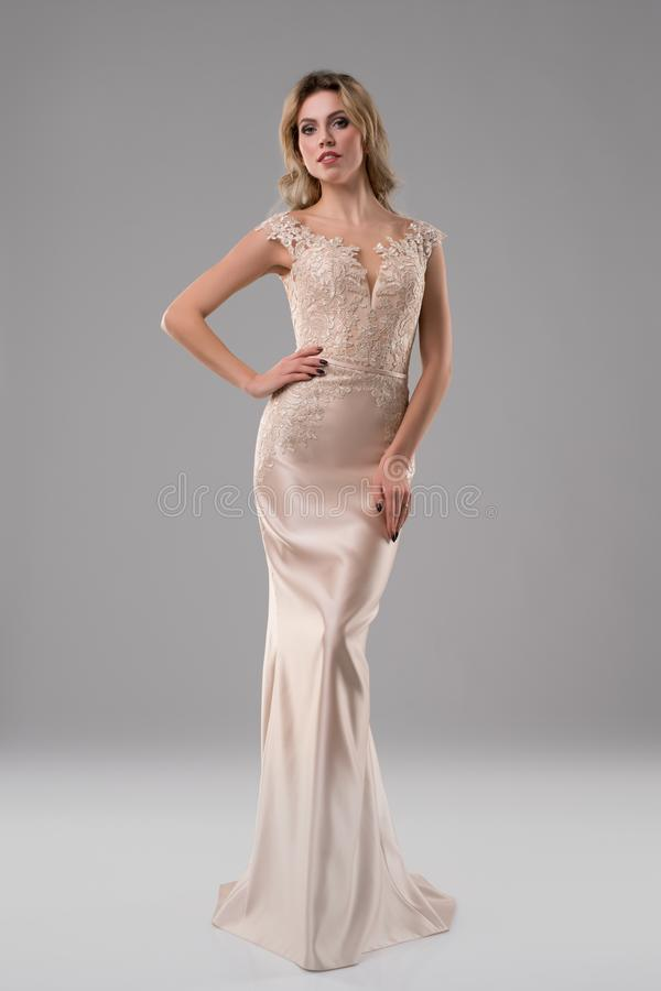 Pretty girl in luxurious evening dress shot stock photography