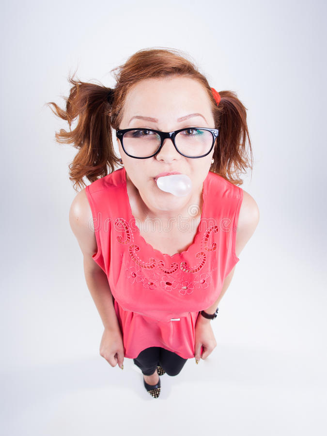 Pretty girl making chewing gum balloons royalty free stock photo