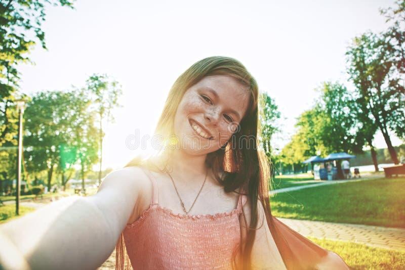 Pretty girl making self-portrait selfie stock photography