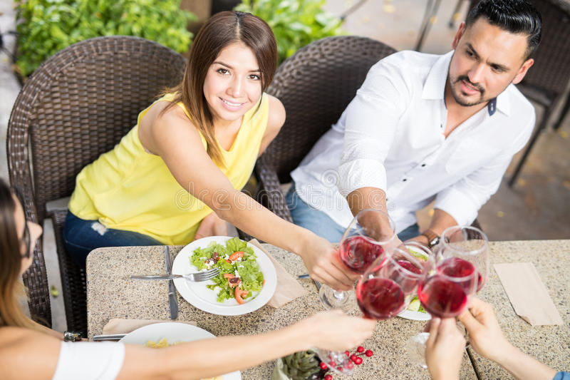 Pretty girl making a toast with wine royalty free stock photo