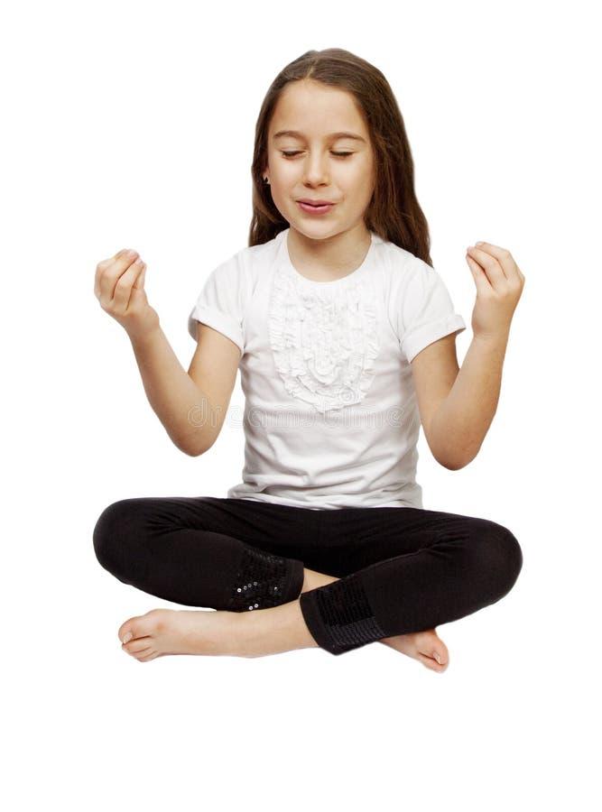 Pretty girl making yoga royalty free stock photos