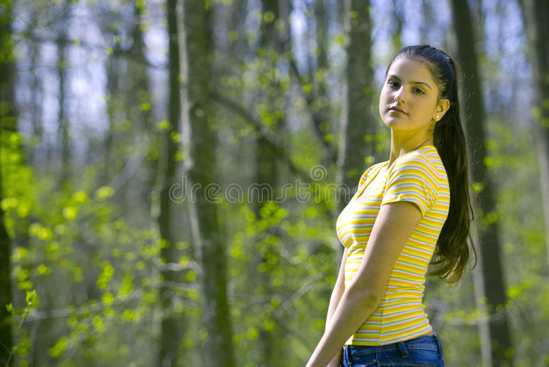 Pretty girl modeling in forest royalty free stock photos
