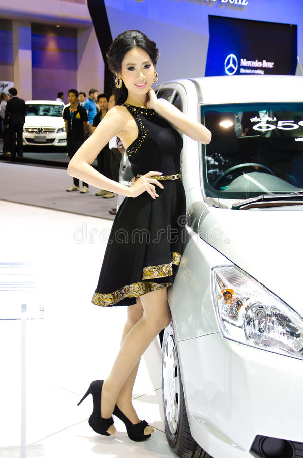 Pretty girl in motor show. BANGKOK - DECEMBER 3: Unidentified model on display at the 28th Thailand International Motor Expo on December 3, 2011 in Bangkok royalty free stock photography