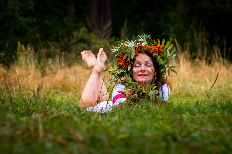 Pretty girl in national dress. In a forest stock images