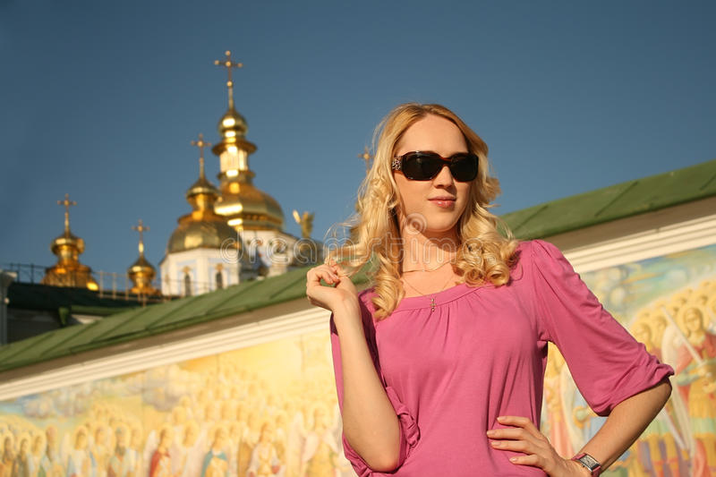 Pretty girl near the cathedral royalty free stock image