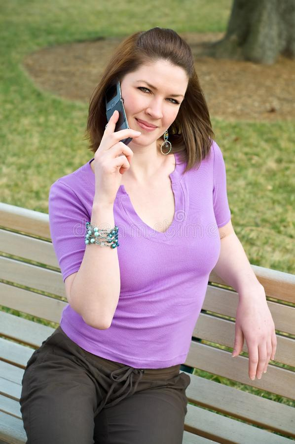 Pretty Girl On Park Bench Talking Cell Phone