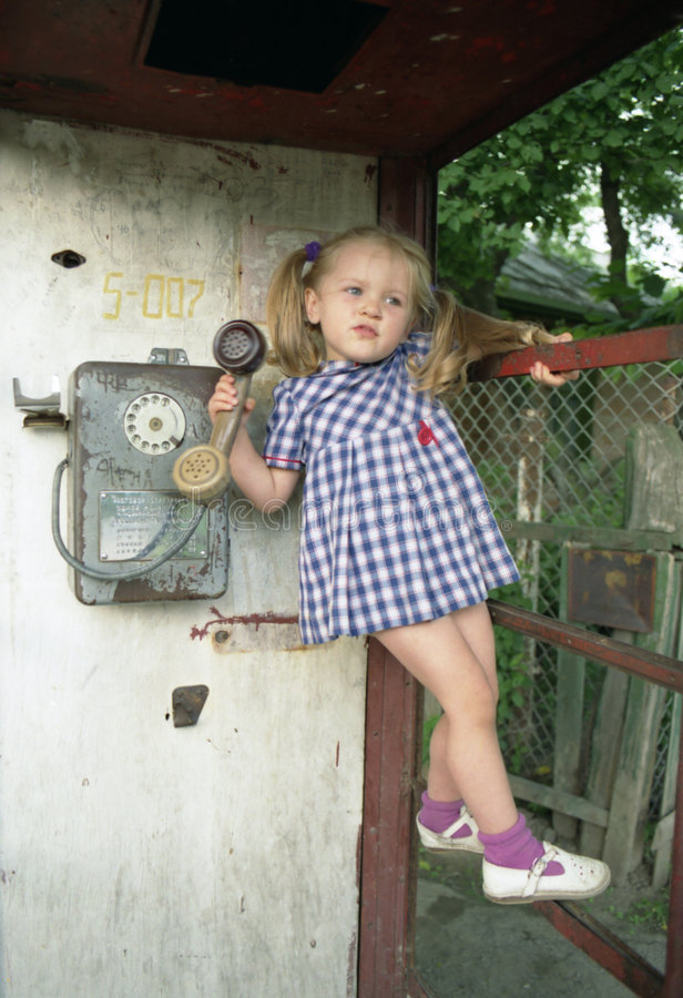 Download Pretty Girl In The Phone Booth Royalty Free Stock Photo - Image: 517245