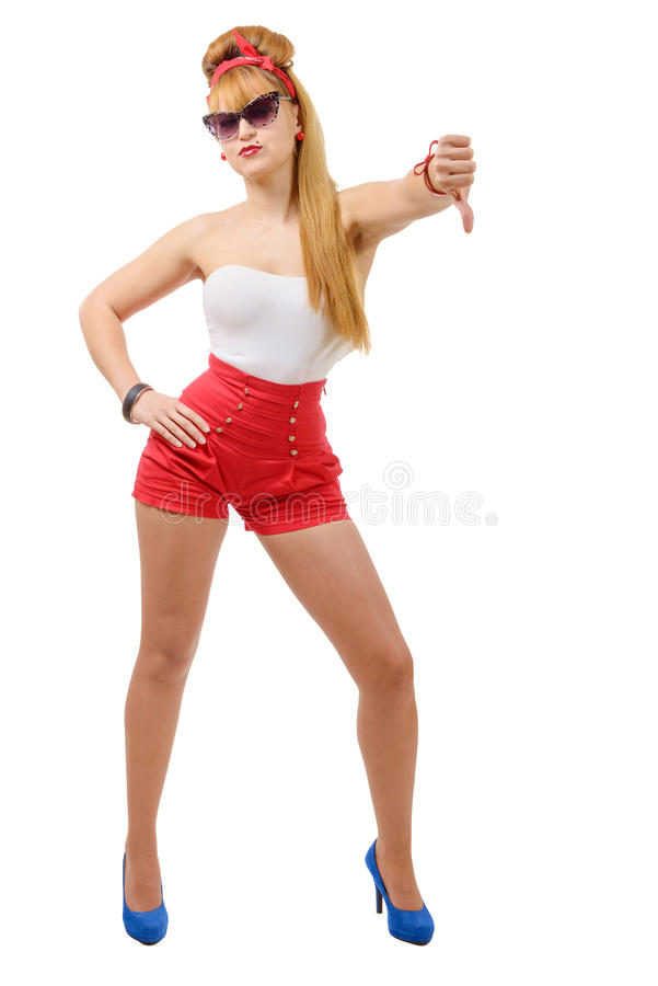 Pretty girl pin-up in shorts with the thumb down. Beauty, fashion stock photo
