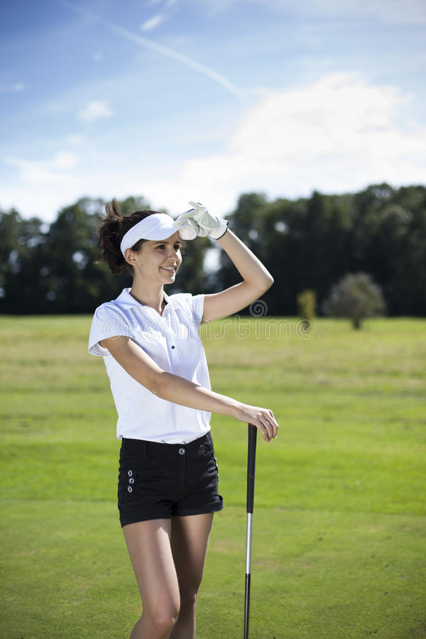 Download Pretty Girl Playing Golf On Grass Royalty Free Stock Image - Image: 33580956
