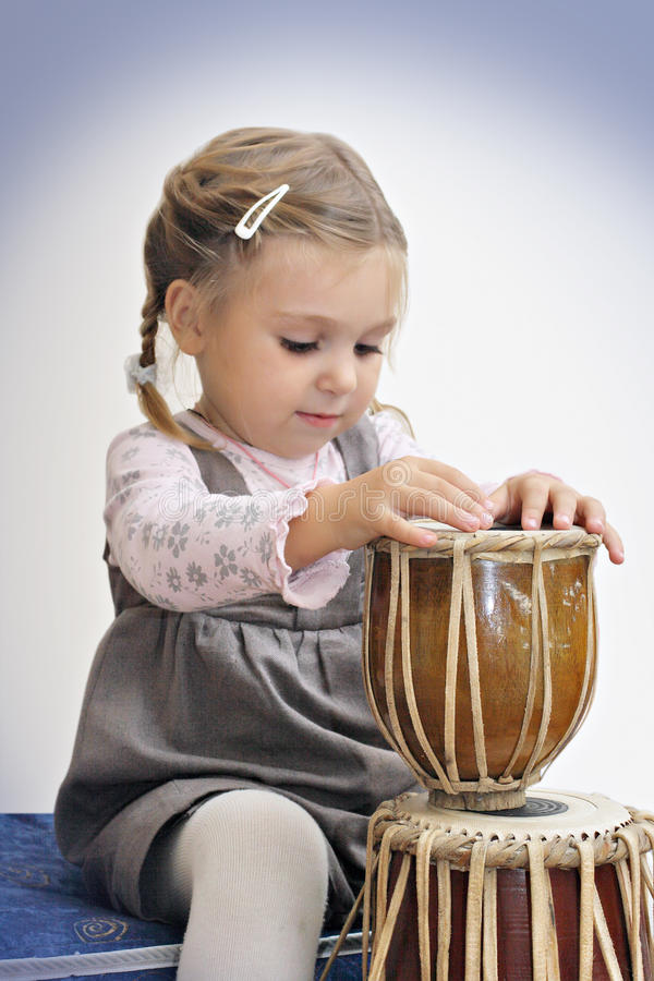 Free Pretty Girl Playing The African Drums Stock Photos - 15457723