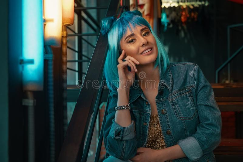 Cheerful girl portrait with stylish blue hair and pretty face ex stock image