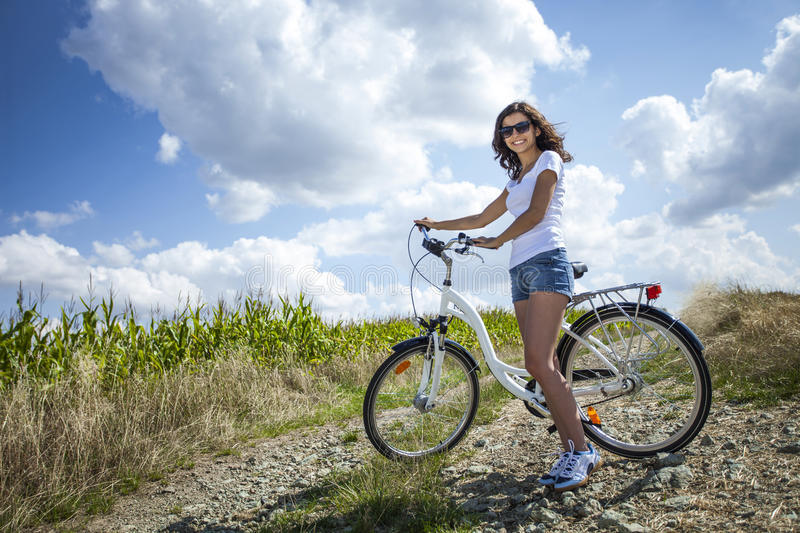 Download Pretty girl pose with bike stock photo. Image of smiling - 33580976