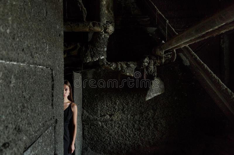 Pretty girl posing indoors where concrete is cast stock photo