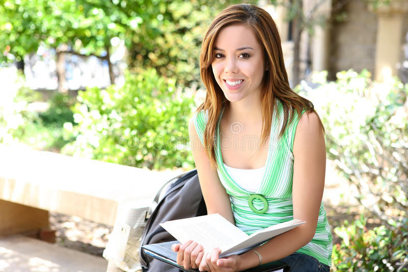 Pretty Girl Reading at School stock photography