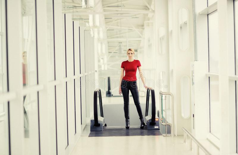 pretty girl in the airport royalty free stock photo