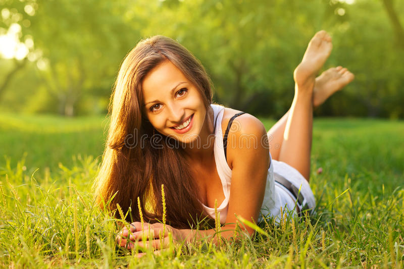 Pretty girl relaxing outdoor royalty free stock photography