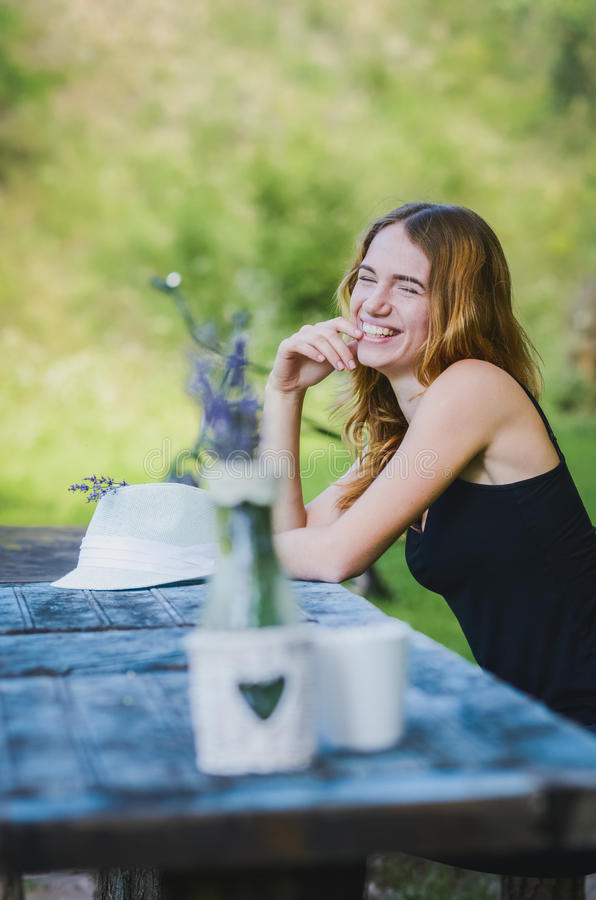 Pretty girl resting on nature royalty free stock photography