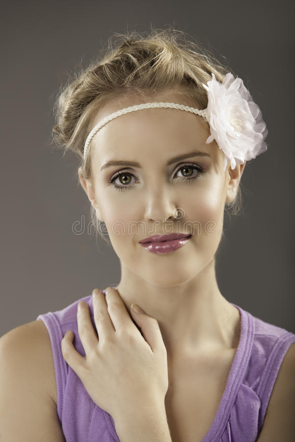 Pretty girl with romantic hairstype wearing flower hairband stock images