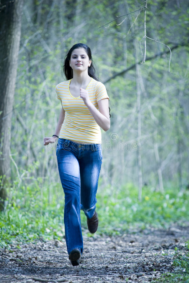 Pretty Girl Running royalty free stock photo