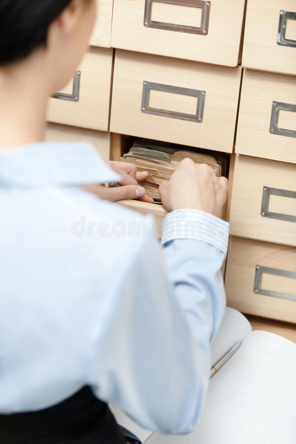 Download Pretty Girl Seeks Something In Card Catalog Stock Image - Image: 26630923