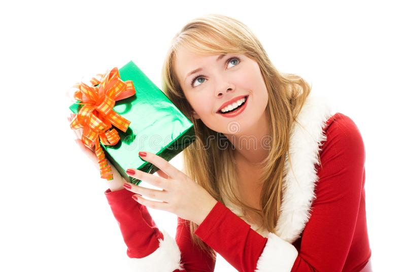 Download Pretty Girl Shaking A Christmas Present Stock Photo - Image: 6817802