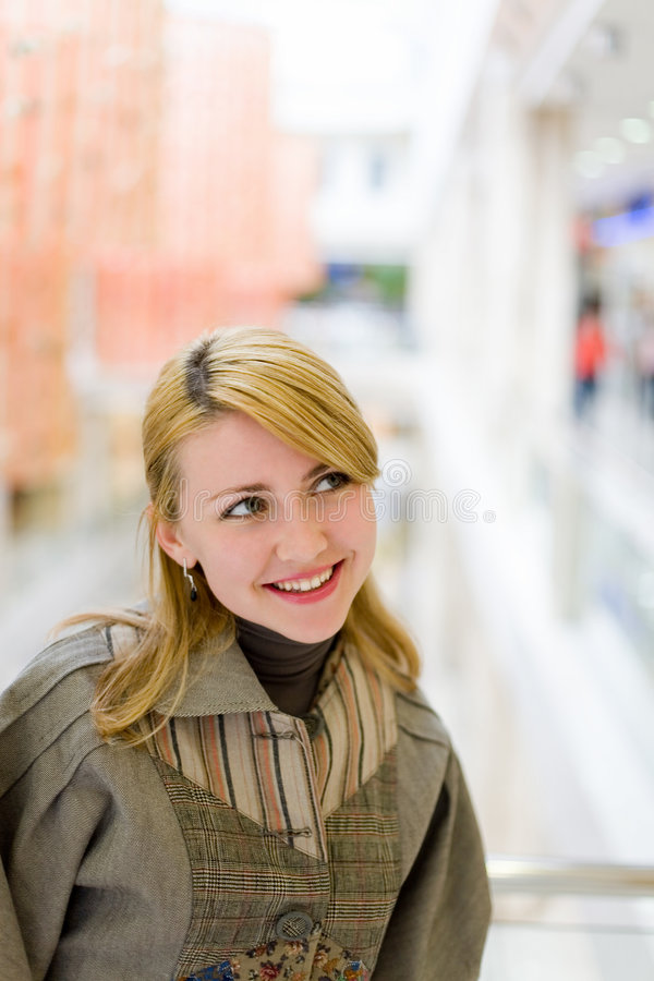 Pretty girl in shop #4. Pretty girl in shop. Smiling face royalty free stock photography